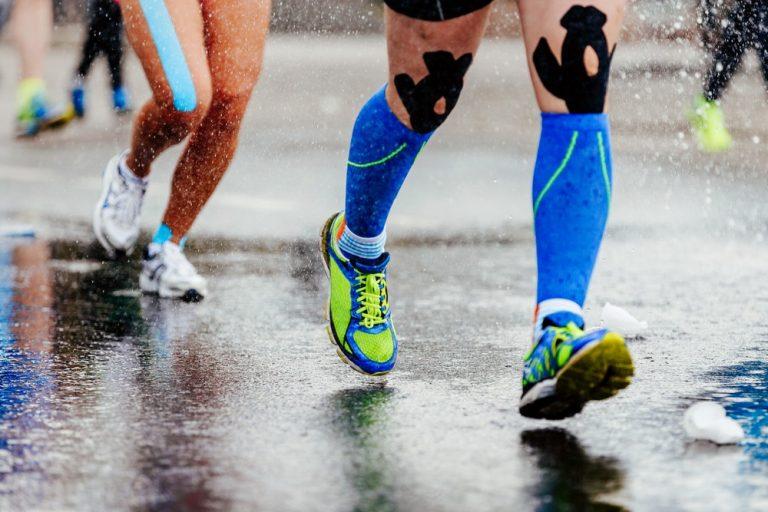 runners using kinesiology tape