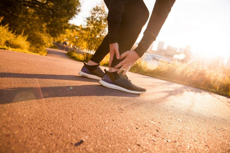 runner holding an injured ankle