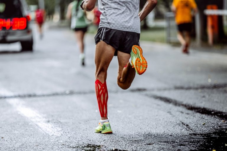runner wearing red kinesiology tape