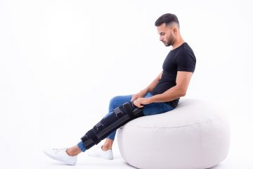 man wearing supportive leg brace while sitting on beanbag chair