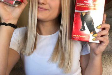 Megan Hering, former Mueller Sports Medicine Marketing Team Member holding Mueller products