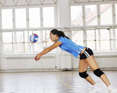 woman bumping a volleyball