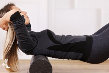 woman using foam roller for her back pain