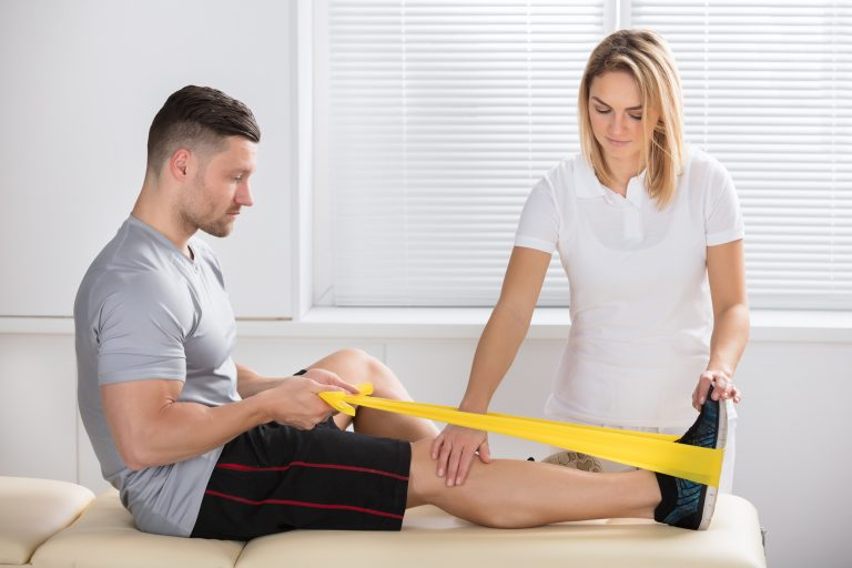 sports medicine professional working with a patient