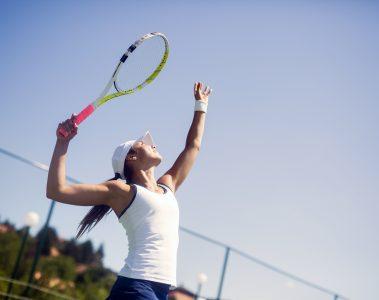 woman serving in tennis