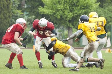 high school football player making a tackle