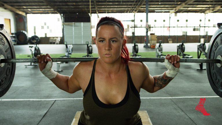 woman squatting bar