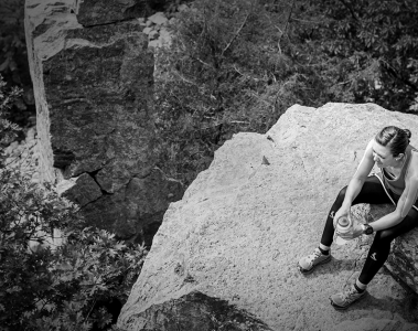 hiker taking a break at the top of a cliff