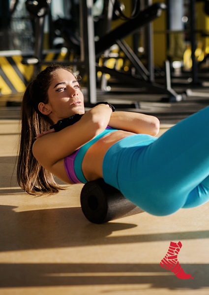 woman using foam roller to aid workout recovery