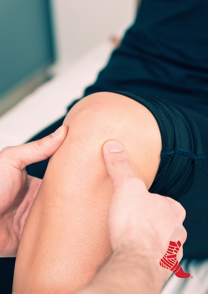 someone assessing a hurt knee