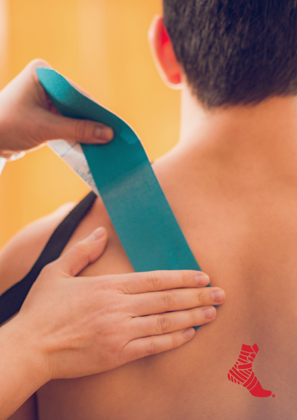 kinesiology tape being applied to a man's back