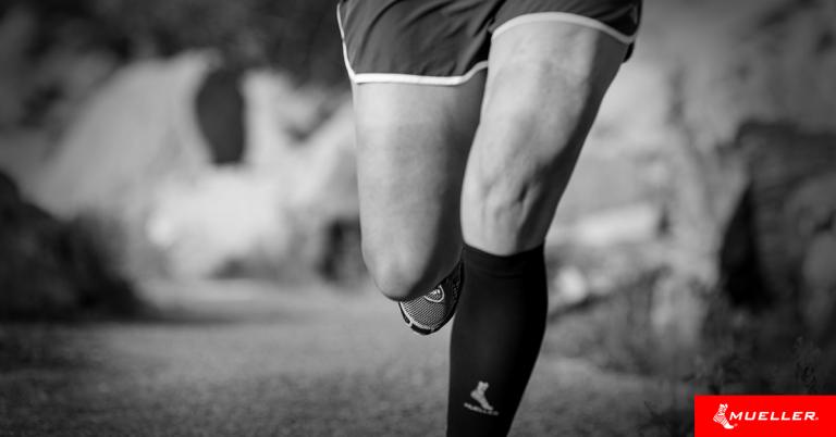 runner wearing Mueller graduated compression calf sleeves