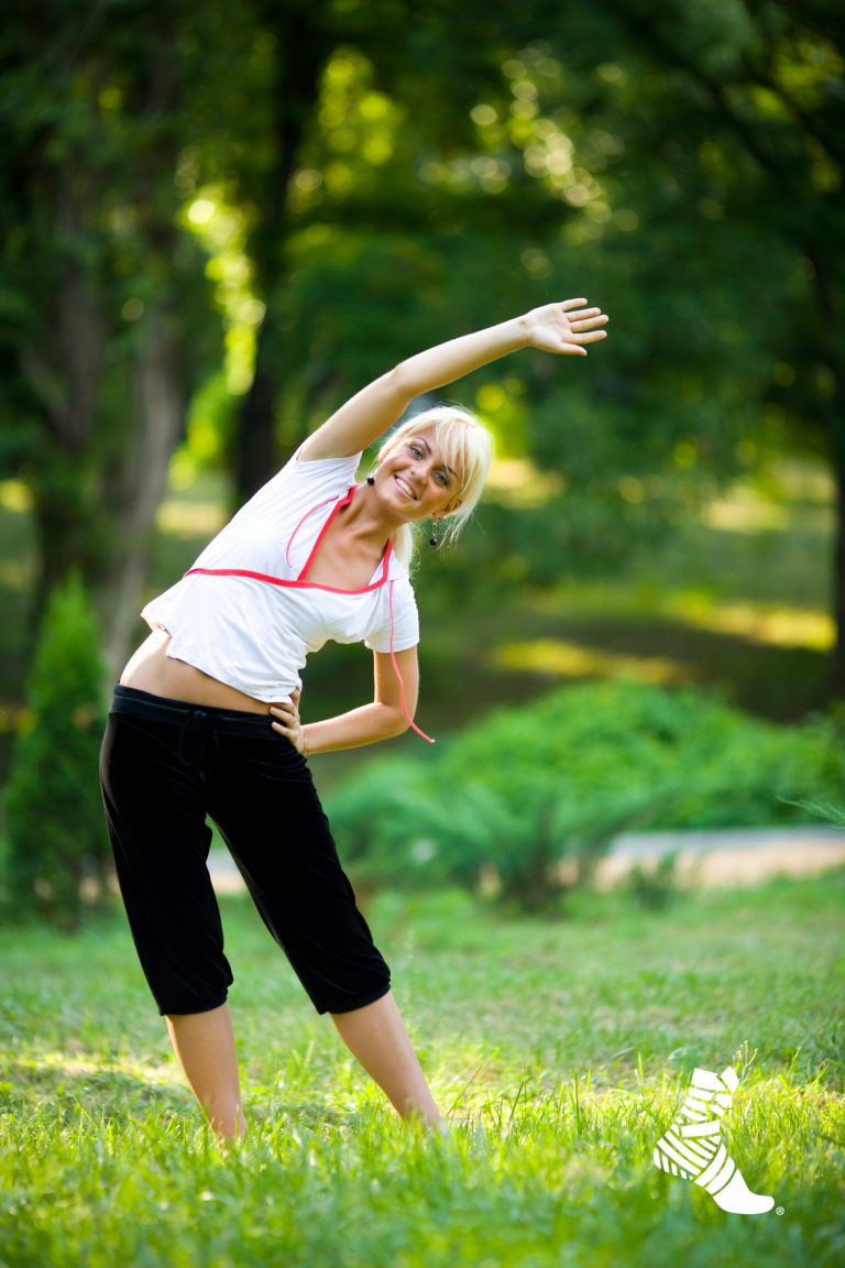 woman stretching prior to exercise