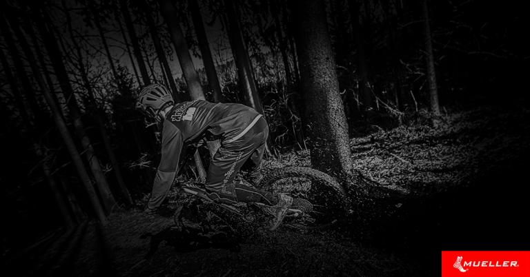 person biking through the woods