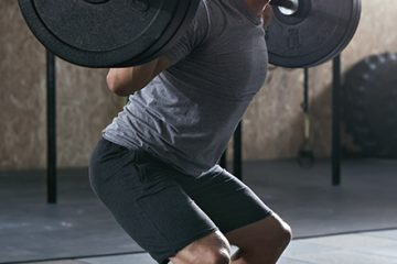 man lifting heavy weights