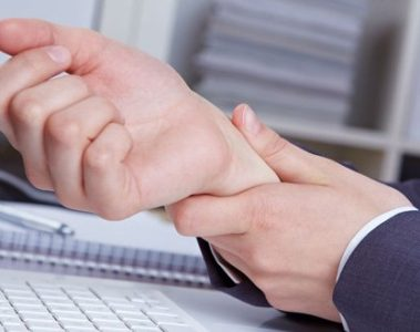 man holding wrist with carpal tunnel syndrome