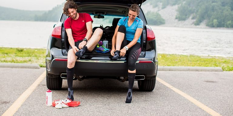 runners putting on Mueller compression socks before running
