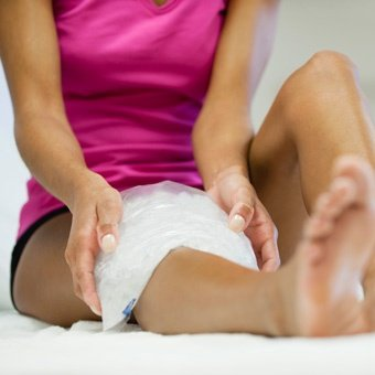 woman icing her knee