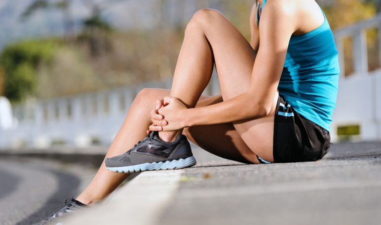 woman taking a break from exercising