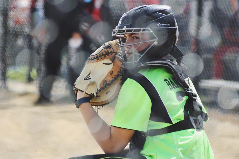 female catcher playing softball