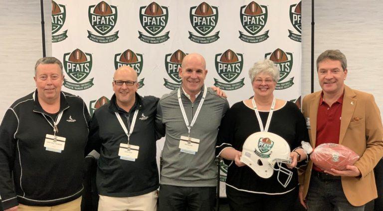 Members of Mueller Sports Medicine posing at PFATS Sponsor Ceremony