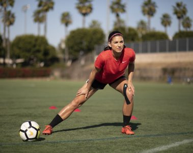 US Women's Soccer player Alex Morgan, wearing Mueller M-Wrap and Kinesiology tape